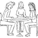 3 Personen am Tisch im Gespräch